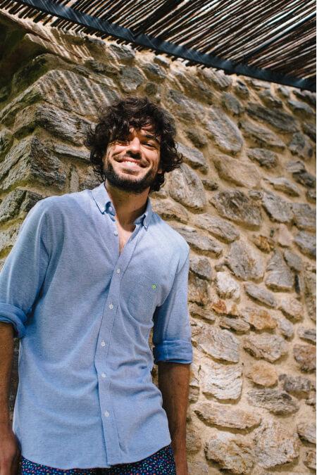 Man wearing mottled blue cotton pique shirt
