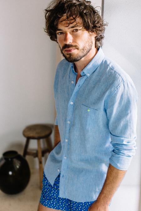 Man wears a Mixed Blue shirt