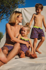 mother and daughter wearing matching swimsuits graffiti