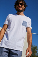 man wearing a white t-shirt with azulejos pocket