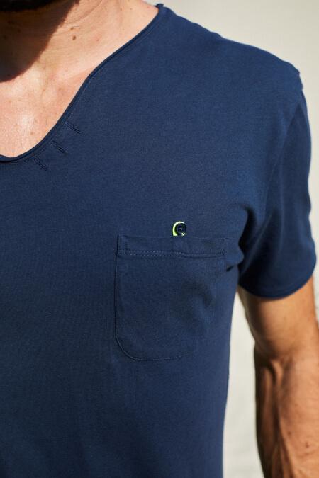man wearing a navy t-shirt with tunisian collar