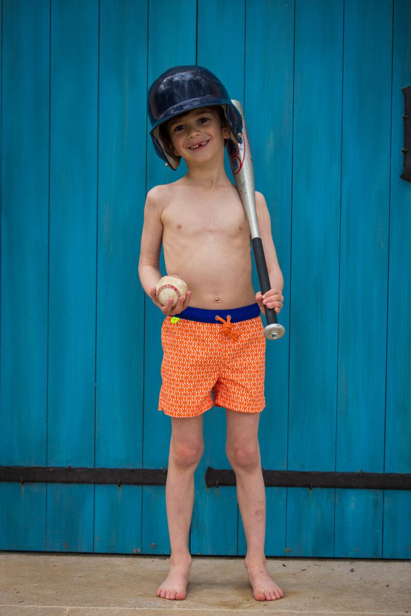 Boy wearing a swimsuit with elasticated belt orange Kangaroos