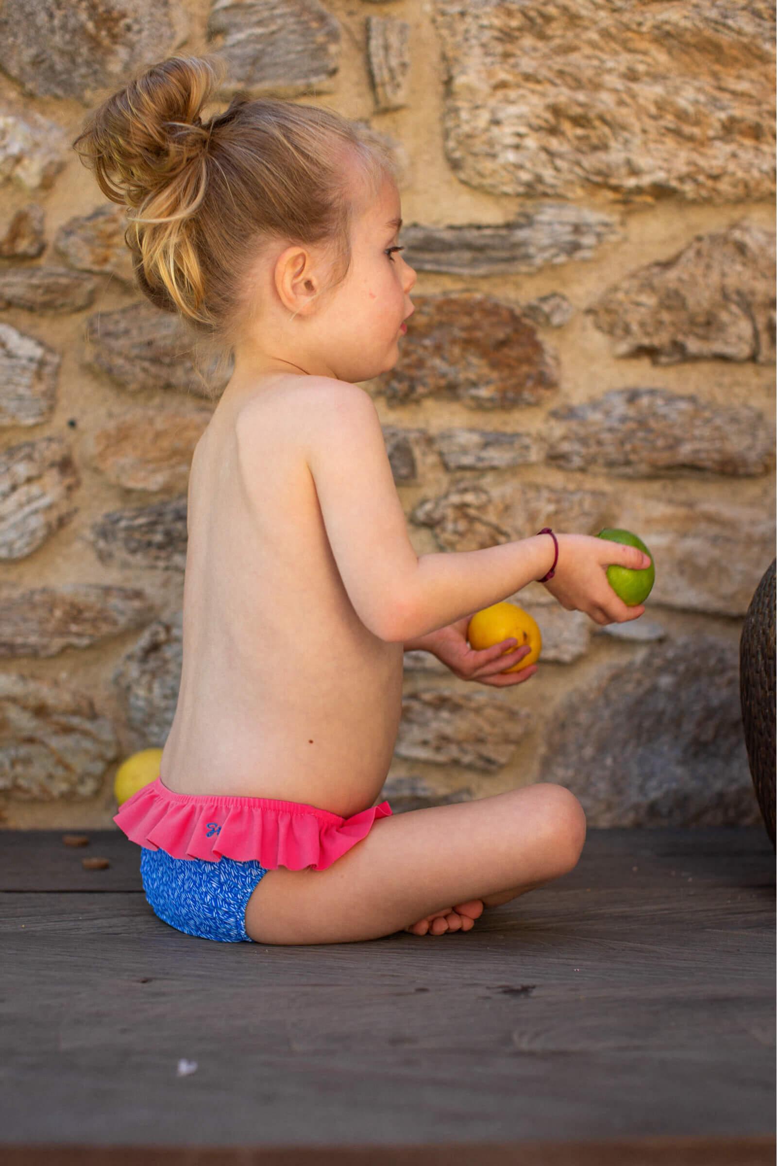 Baby girl wearing Riviera bikini bottom