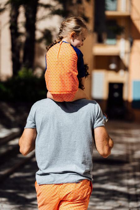 Girl wearing a mixed anti-uv t-shirt orange kangaroos