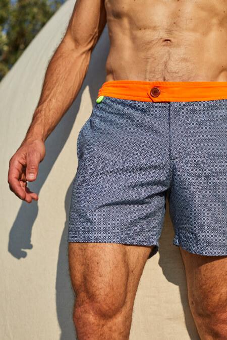 Man wearing a swimsuit with buttuned belt Air Navy Pop Azulejos