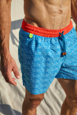 Man wearing a Turquoise Tropics swimsuit with elasticated belt