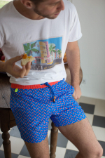 Man wearing a Blue Seagulls swimsuit with elasticated belt
