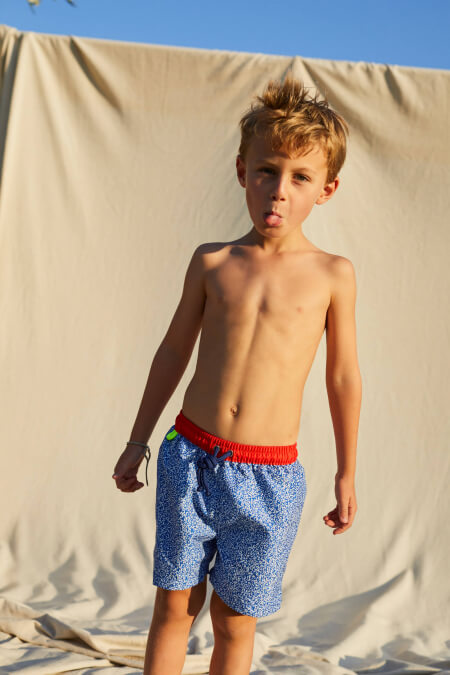 Boy wearing a swimsuit with buttoned belt Meno Off the Coast