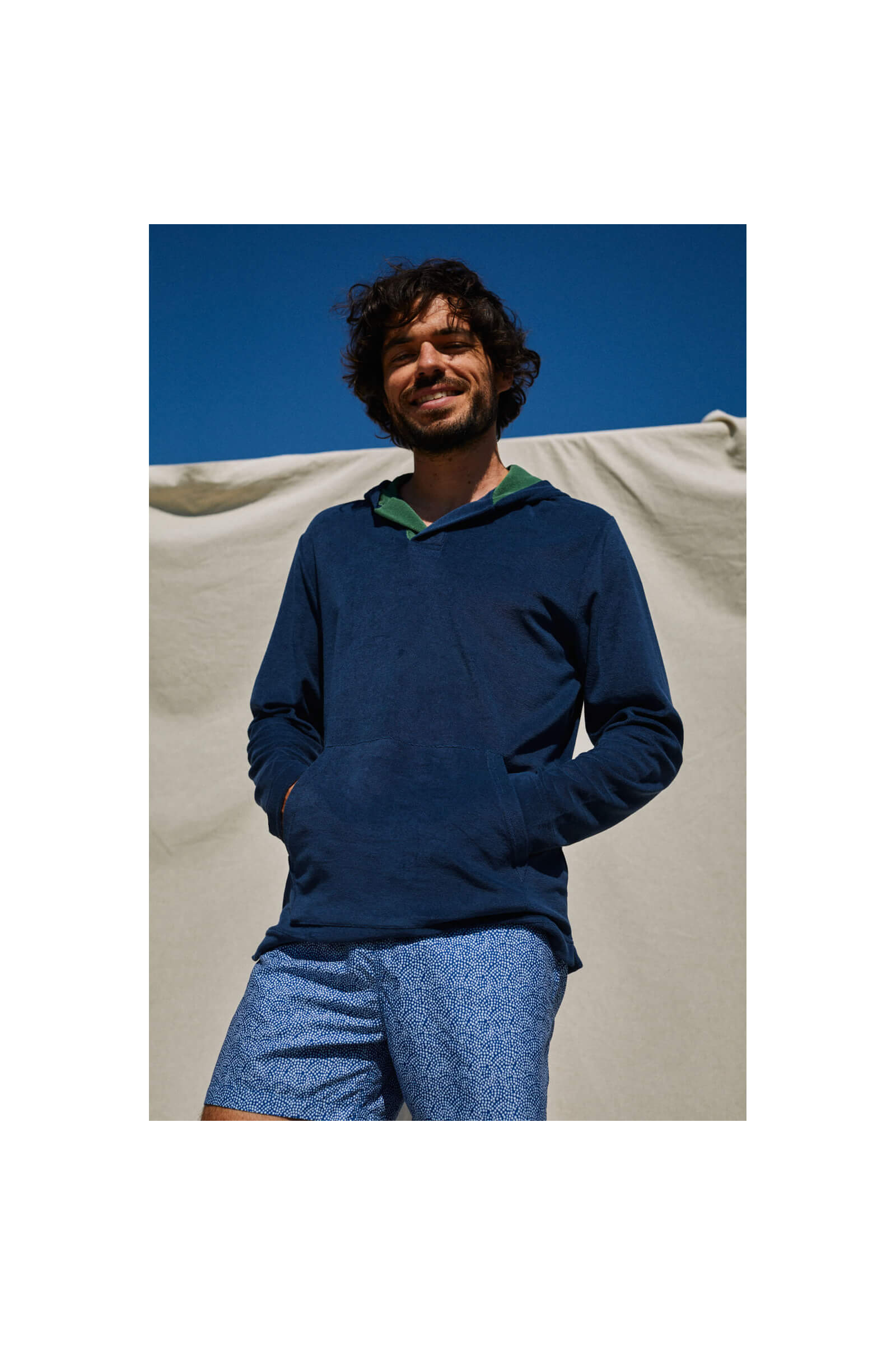 man wearing a navy terry cloth sweat