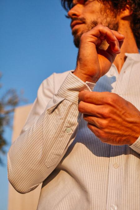 man wearing a Sky blue striped mandarin collar shirt