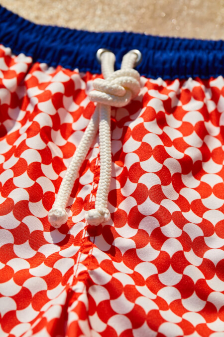 Boy wearing a swimsuit with elasticated belt Meno Red Woodstock
