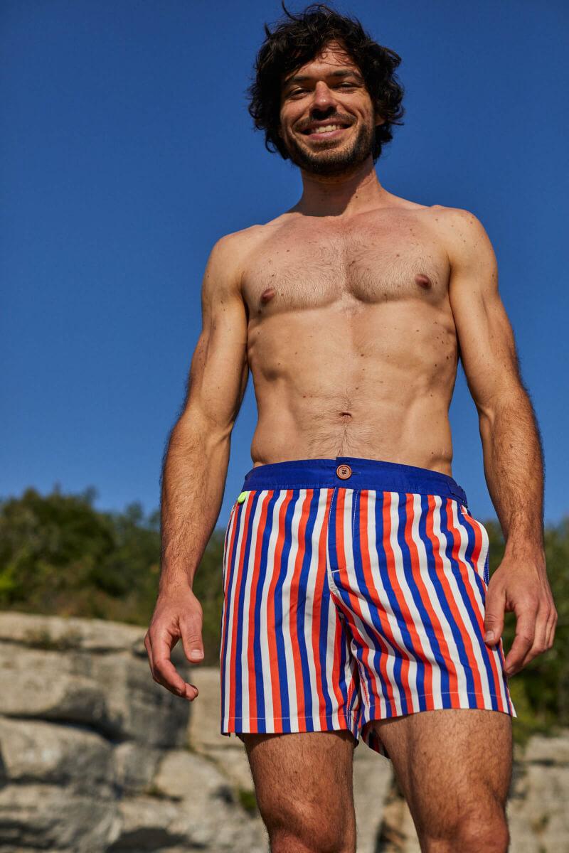 Man wearing a swimsuit with buttoned belt La Baule